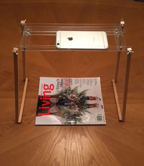Picture of stand with device looking down on magazine